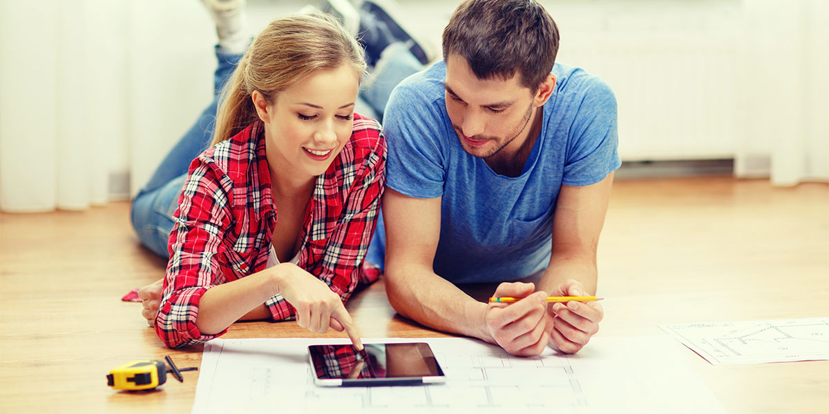 Young couple looking at house plans