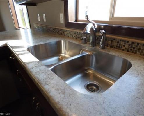Under mount sink in a kitchen.